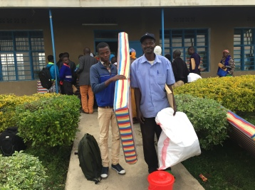 A selected students with his father taking supplies